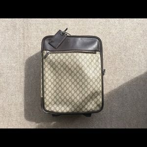 Vintage Gucci Rolling luggage